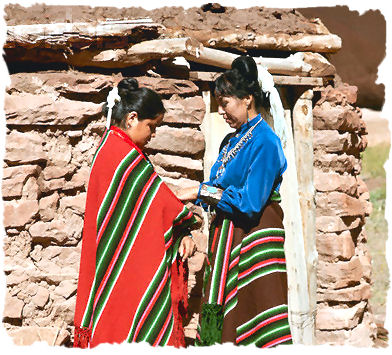 Mother and Daughter Wearing Blankets in Navajo Design