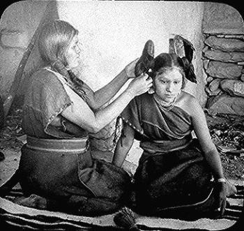 Hopi Woman Placing Ornaments in Hair